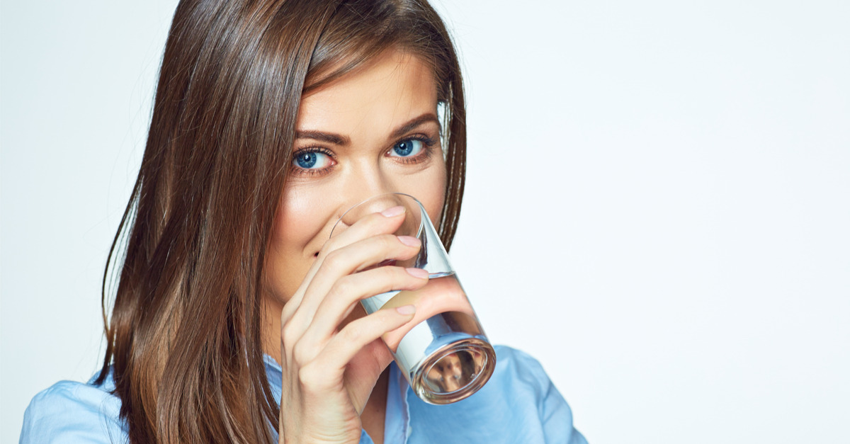 lasy drinking a glass of ionized water